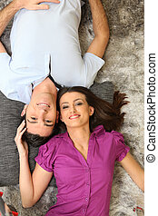 Couple laying on rug