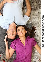 Couple laying on rug