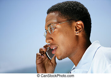 Businessman taking call whilst on the move