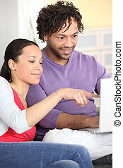 Couple happily browsing the internet