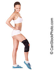 Girl with trauma of knee in brace.. Isolated.
