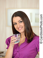 Attractive woman drinking a glass of water