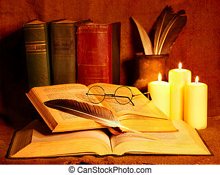 Stack old book and candle. Education.