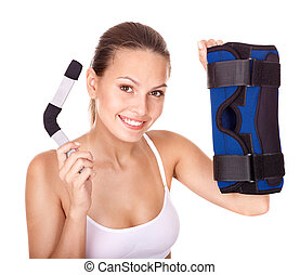 Woman holding hinged knee braces. - Happy girl holding...