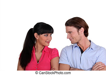 Young couple flirting in a studio