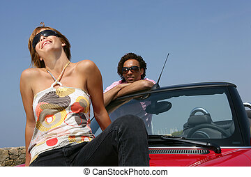 Couple with convertible car