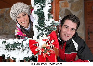 Couple staying in a Christmas chalet