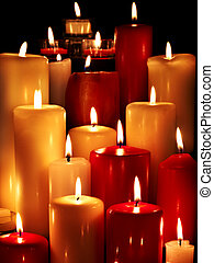 Group of candles on black background. - Group of burning...