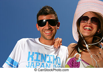 Couple listening to music on a sunny day