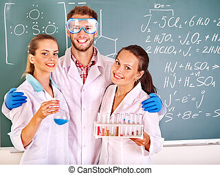 Group chemistry student with flask.