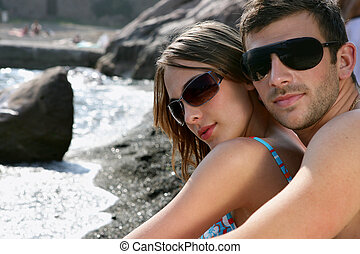 Couple stood by beach