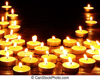 Group of candles on black background - Group of burning...