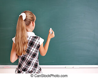 Schoolchild writing on blackboard - Happy schoolchild...
