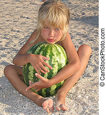 Child with watermelon.
