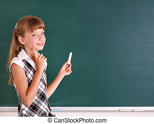 Schoolchild writing on blackboard. - Happy schoolchild...