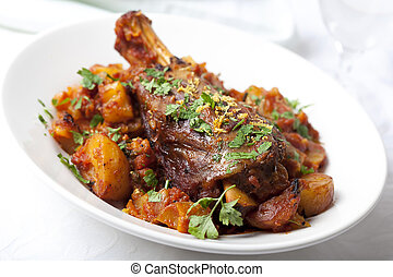 Lamb Shanks - Lamb shank dinner, with vegetables, topped...