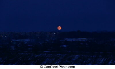 Time Lapse of Moon Rising over city. HD H.264