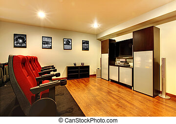 Home TV movie theater entertainment room interior.