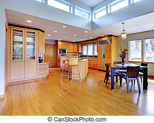 Large luxury modern wood kitchen with granite counter tops -...