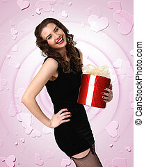 Woman in black dress with a gift box