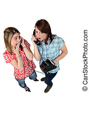 Girls gossiping on the phone