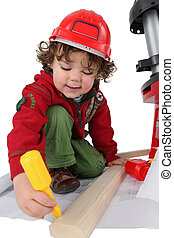 little boy disguised as carpenter