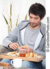 portrait of a young man at breakfast
