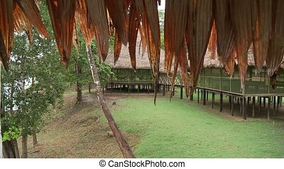 Hamock in Lodge - People In Hamock in Lodge in rainforest...
