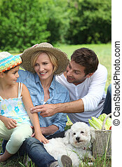 Family with small white dog