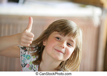 Young girl giving the thumbs up