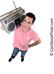 Young man with a ghettoblaster