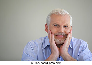 Grey-haired man thinking back on his life
