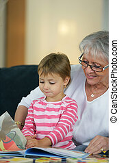 grandmother taking care of her granddaughter