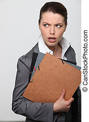 Confused office worker with paperwork
