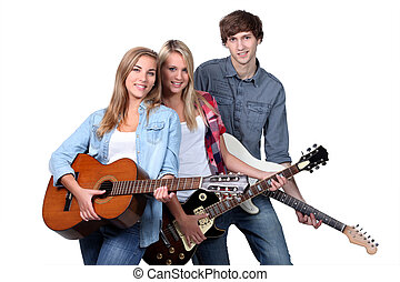 Three teenage guitar players