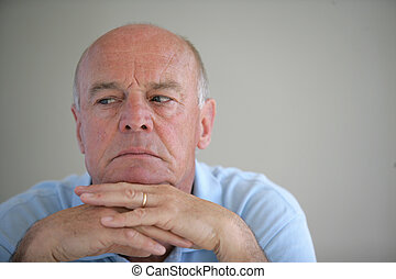 A worried elderly man