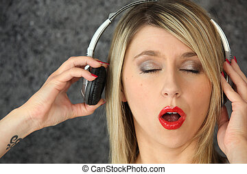 woman eyes shut listening to music