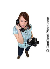 Young woman with a landline phone