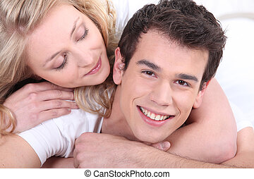 lovely young couple cuddling
