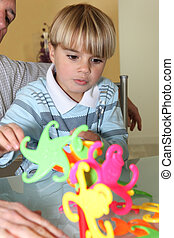 Little boy playing with a colourful toy