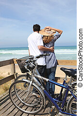 Couple with bikes by the sea