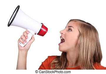 Studio shot of a girl shouting into a megaphone