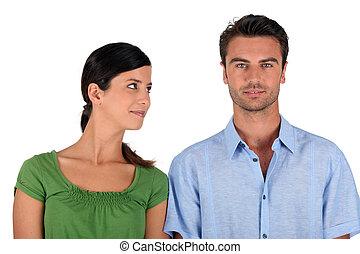 Woman looking at a man