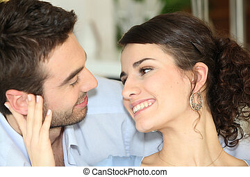 Couple talking at home