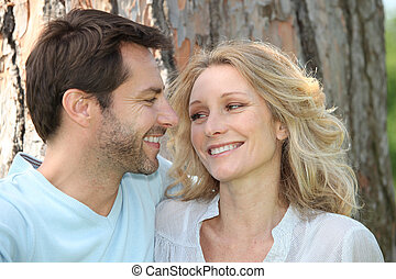 Couple in front of a tree