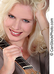 Blonde woman with guitar
