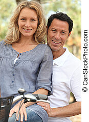 portrait of a couple on a bicycle