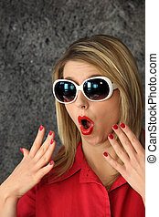 Shocked woman wearing sunglasses