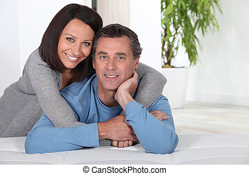 Couple leaning on bed
