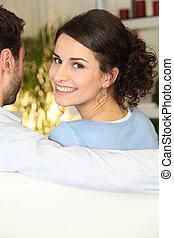 woman sitting on sofa with boyfriend